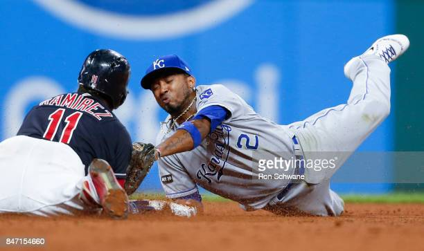 Jose Ramirez of the Cleveland Indians is safe at second base with a double as Alcides Escobar of the Kansas City Royals attempts the tag during the...