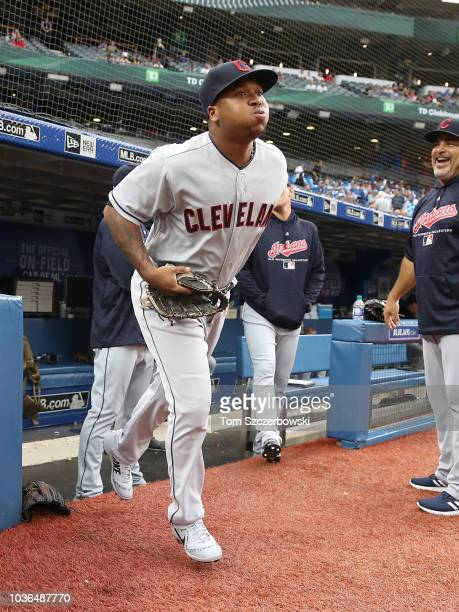 Jose Ramirez of the Cleveland Indians jogs out of the dugout to stretch before the start of MLB game action against the Toronto Blue Jays at Rogers...