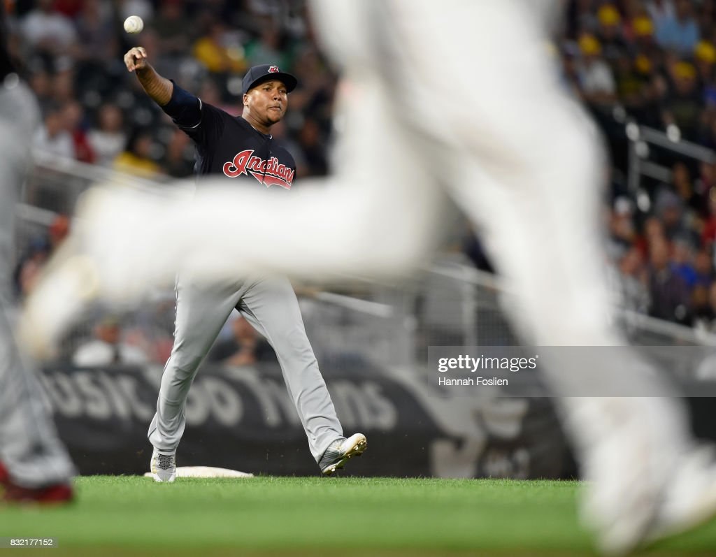Jose Ramirez #11 of the Cleveland Indians makes a play at third base to get out Miguel Sano of the Minnesota Twins at first base during the fourth inning of the game on August 15, 2017 at Target Field in Minneapolis, Minnesota.