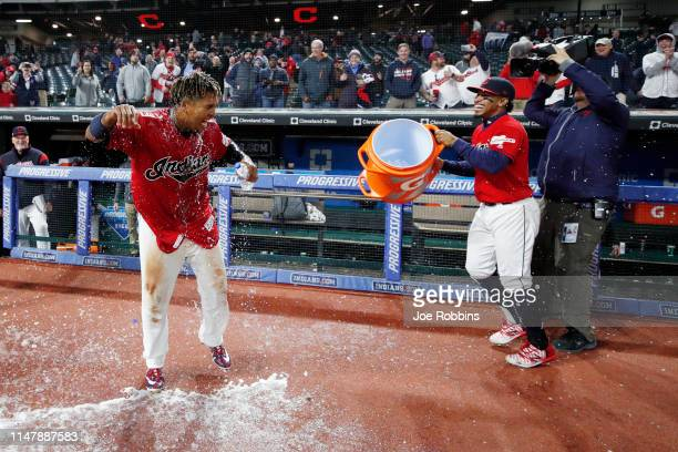 Jose Ramirez of the Cleveland Indians reacts after being doused with Gatorade by Francisco Lindor after a walk-off two-run home run in the ninth...