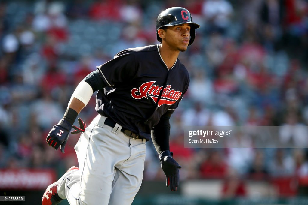 Jose Ramirez #11 of the Cleveland Indians runs to first base during a game against the Los Angeles Angels of Anaheim at Angel Stadium on April 4, 2018 in Anaheim, California.