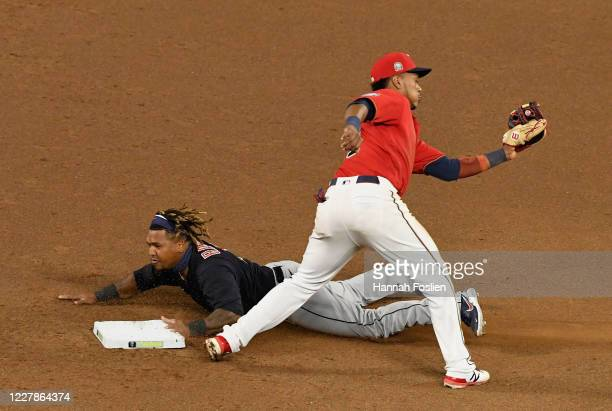 Jose Ramirez of the Cleveland Indians steals second base against Jorge Polanco of the Minnesota Twins during the sixth inning of the game at Target...