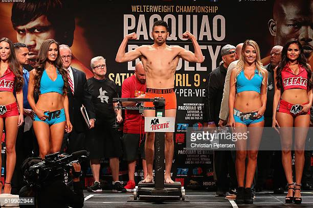 Jose Ramirez poses on the scale during his official weigh-in at MGM Grand Garden Arena on April 8, 2016 in Las Vegas, Nevada. Ramirez will face Manny...