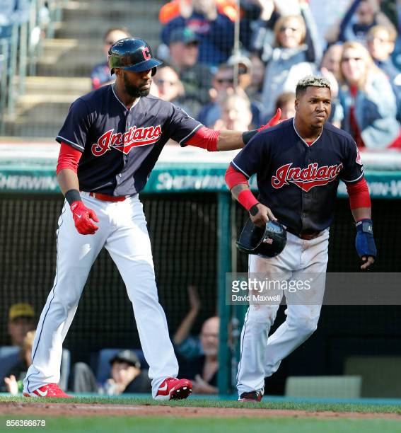 Jose Ramirez the Cleveland Indians is congratulated by teammate Yandy Diaz after scoring against the Chicago White Sox in the first inning at...