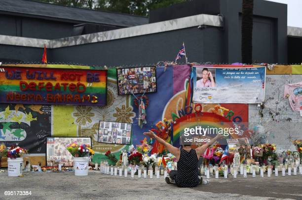 Jose Ramirez who survived the mass shooting at the Pulse gay nightclub reacts as he visits the site one year after the shooting on June 12 2017 in...