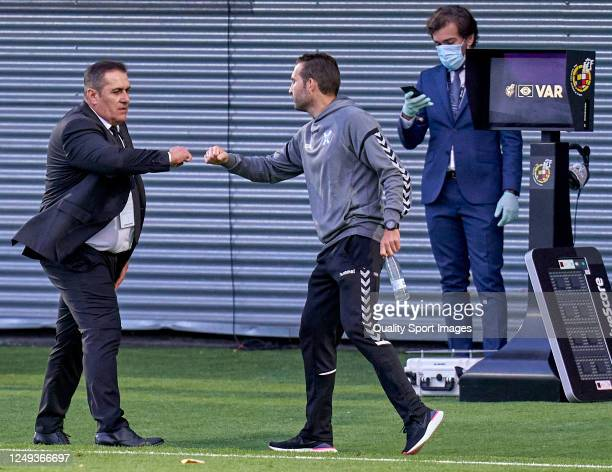 Jose Ramon Sandobal head coach of Fuenlabrada competes for the ball with Ruben Baraja head coach of Tenerife during the La Liga SmartBank match...