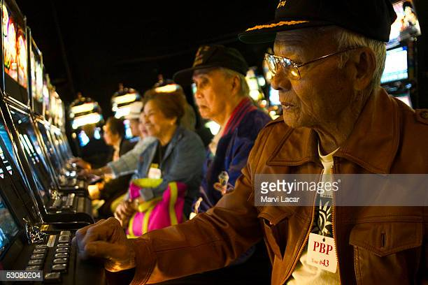 Jose Recto plays the cash machines at a northern California casino May 5 2005 near San Francisco Like many Filipino WWII veterans he is living in the...