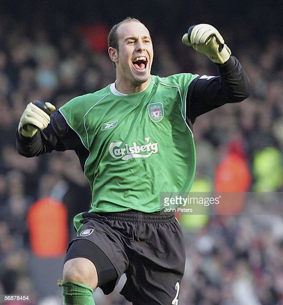 Jose Reina of Liverpool celebrates Peter Crouch scoring the first goal during the FA Cup Fifth Round match between Liverpool and Manchester United at...