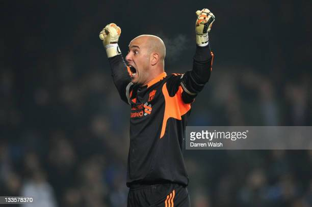 Jose Reina of Liverpool celebrates the winning goal during the Barclays Premier League match between Chelsea and Liverpool at Stamford Bridge on...