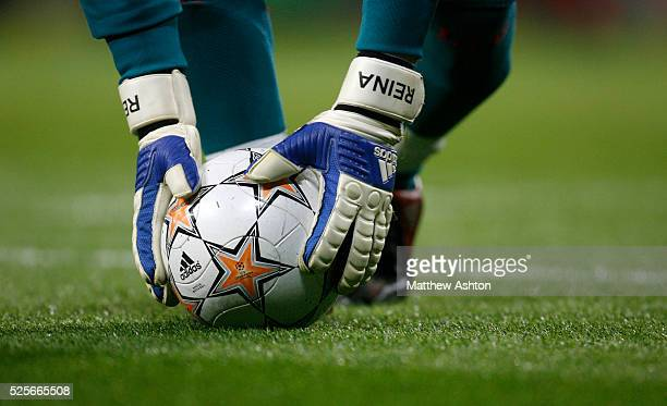 Jose Reina of Liverpool wearing his personal gloves picks up an official Adidas UEFA Champions League match ball