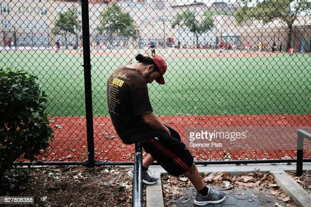 Jose rests after shooting heroin near where John Jay College of Criminal Justice students are conducting interviews with heroin users as part of a...