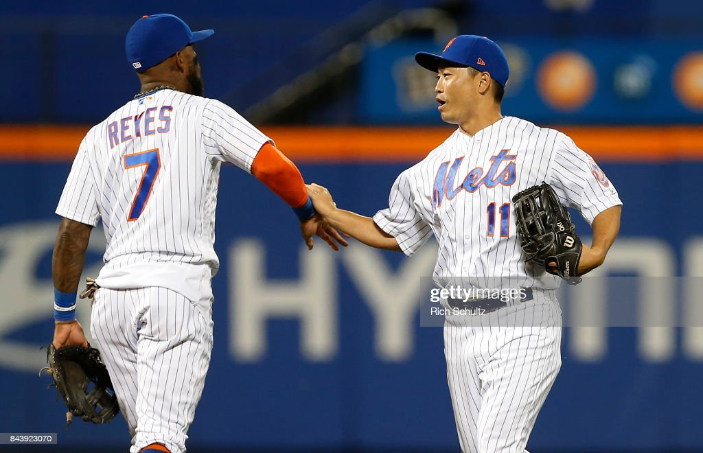 Jose Reyes #7 and Norichika Aoki #11 of the New York Mets congratulate each other after defeating the Cincinnati Reds 7-2 during a game at Citi Field on September 7, 2017 in the Flushing neighborhood of the Queens borough of New York City.