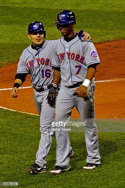 Jose Reyes and Paul Lo Duca of the New York Mets celebrate after scoring on a two RBI hit by Carlos Delgado in the sixth inning against the St Louis...