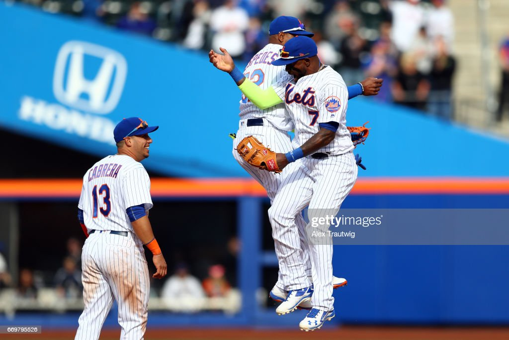 Jose Reyes #7 and Yoenis Cespedes #53 of the New York Mets celebrate after the Mets defeated the Atlanta Braves at Citi Field on Monday April 3, 2017 in the Queens borough of New York City.