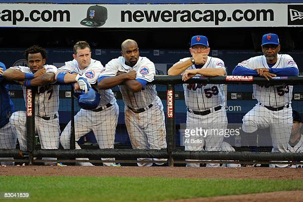 Jose Reyes Brian Schneider Carlos Delgado pitching coach Dan Warthen and manager Jerry Manuel of the New York Mets look on after loosing to the...