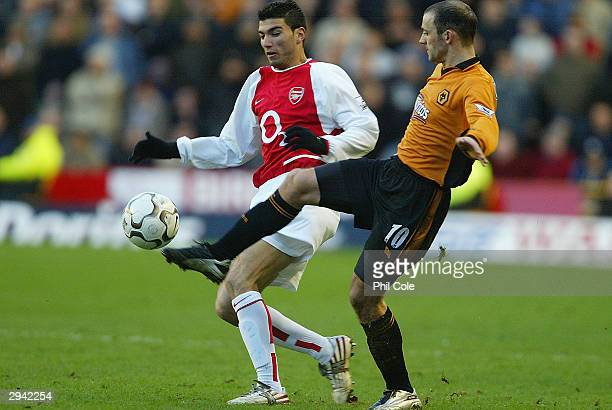 Jose Reyes of Arsenal is tackled by Colin Cameron of Wolves during the FA Barclaycard Premiership match between Wolverhampton Wanderers and Arsenal...