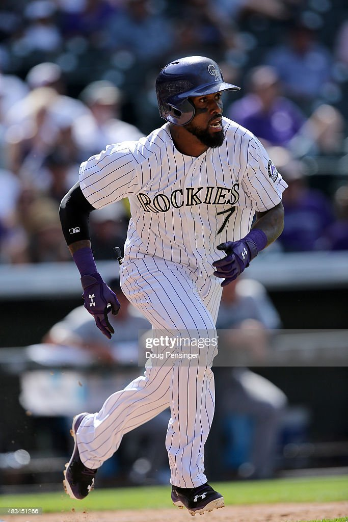 Jose Reyes #7 of the Colorado Rockies takes an at bat and sprints for first against the Seattle Mariners during interleague play at Coors Field on August 5, 2015 in Denver, Colorado. The Rockies defeated the Mariners 7-5 in 11 innings.