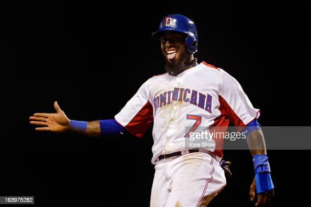 Jose Reyes of the Dominican Republic celebrates after scoring in the fifth inning against the Netherlands during the semifinal of the World Baseball...