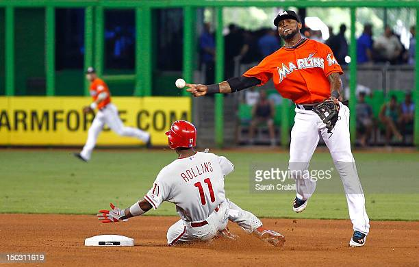 Jose Reyes of the Miami Marlins makes the force out at second before the slide of Jimmy Rollins of the Philadelphia Phillies during a game at Marlins...
