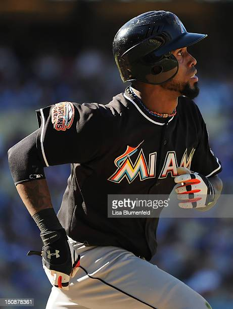 Jose Reyes of the Miami Marlins runs the bases after hitting a homerun against the Los Angeles Dodgers at Dodger Stadium on August 26 2012 in Los...