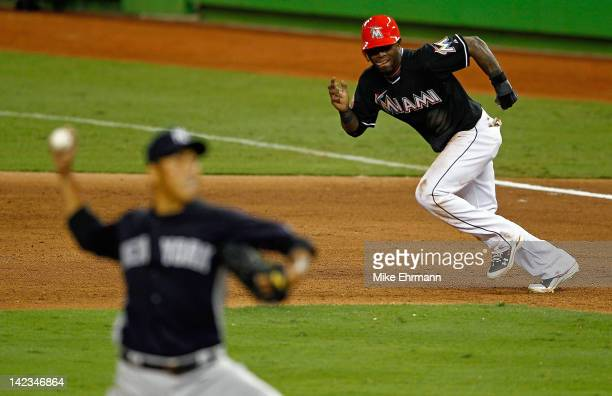 Jose Reyes of the Miami Marlins steals on Hiroki Kuroda of the New York Yankees during a preseason game at Marlins Park on April 2 2012 in Miami...