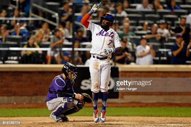 Jose Reyes of the New York Mets celebrates a solo home run in front of Tony Wolters of the Colorado Rockies during the eighth inning at Citi Field on...