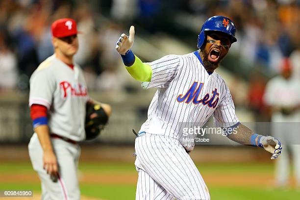 Jose Reyes of the New York Mets celebrates after hitting a game tying two run home run in the bottom of the ninth inning against the Philadelphia...