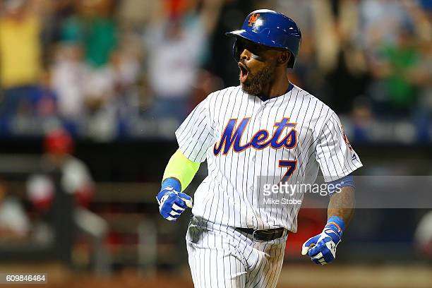 Jose Reyes of the New York Mets celebrates after hitting a game tying tworun home run in the bottom of the ninth inning against the Philadelphia...