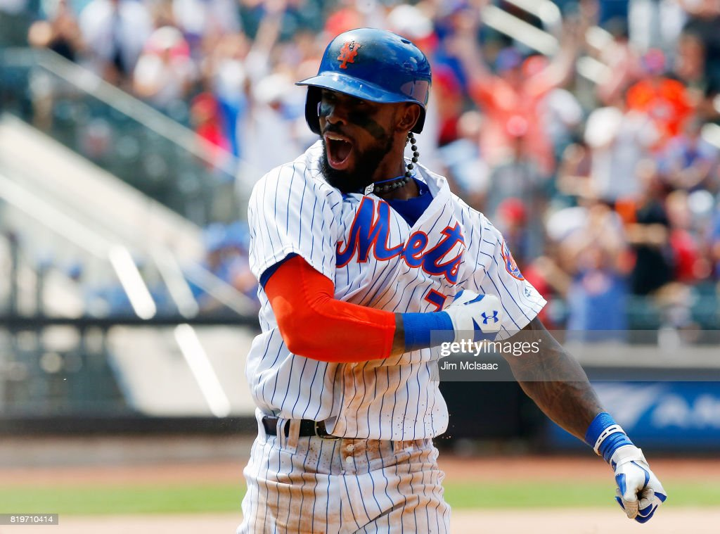 Jose Reyes #7 of the New York Mets celebrates his ninth inning game-winning infield base hit against the St. Louis Cardinals on July 20, 2017 at Citi Field in the Flushing neighborhood of the Queens borough of New York City.