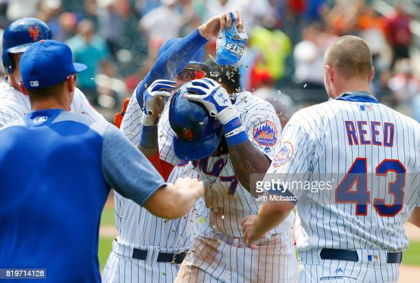 Jose Reyes of the New York Mets celebrates his ninth inning gamewinning infield base hit against the St Louis Cardinals with his teammates on July 20...