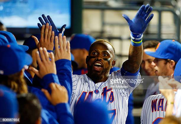 Jose Reyes of the New York Mets celebrates his third inning home run against the Minnesota Twins with his teammates in the dugout at Citi Field on...
