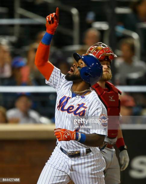 Jose Reyes of the New York Mets celebrates his third inning home run as Tucker Barnhart of the Cincinnati Reds looks on at Citi Field on September 8...