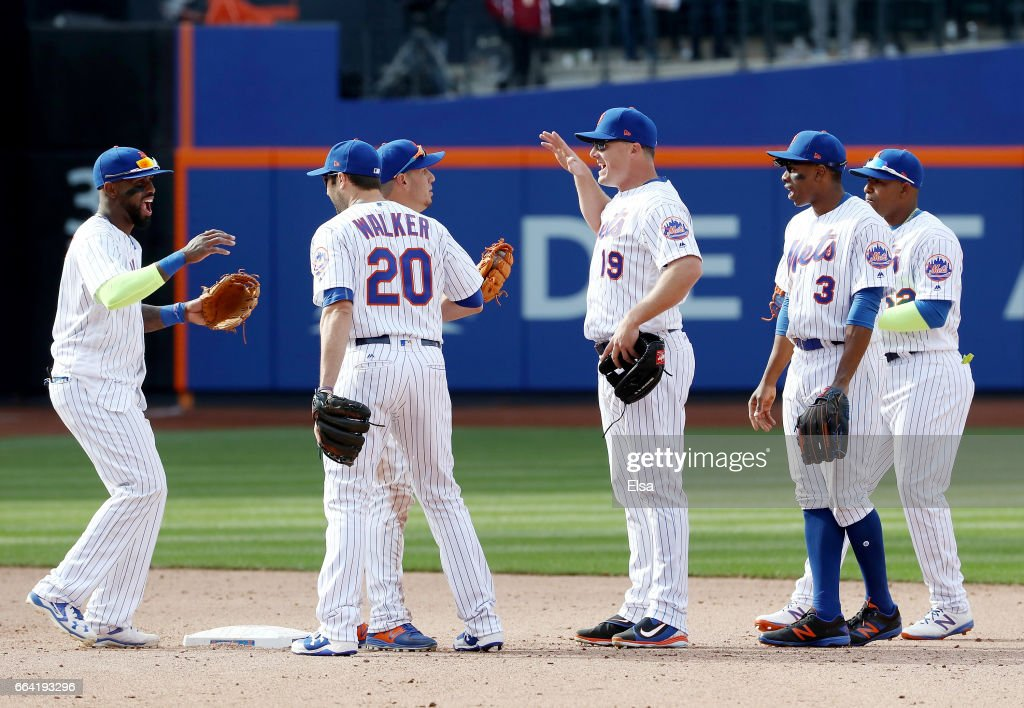Jose Reyes #7 of the New York Mets celebrates the win with teammates Neil Walker #20,Asdrubal Cabrera #13,Jay Bruce #19, Curtis Granderson #3 and Yoenis Cespedes #52 after the game against the Atlanta Braves during Opening Day on April 3, 2017 at Citi Field in the Flushing neighborhood of the Queens borough of New York City.The New York Mets defeated the 6-0.