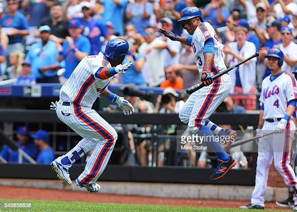Jose Reyes of the New York Mets celebrates with Curtis Granderson after hitting a lead off solo home run in the first inning against the Washington...