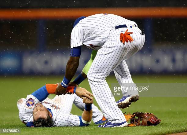 Jose Reyes of the New York Mets checks on injured teammate Asdrubal Cabrera in the third inning against the Miami Marlins on May 6 2017 at Citi Field...