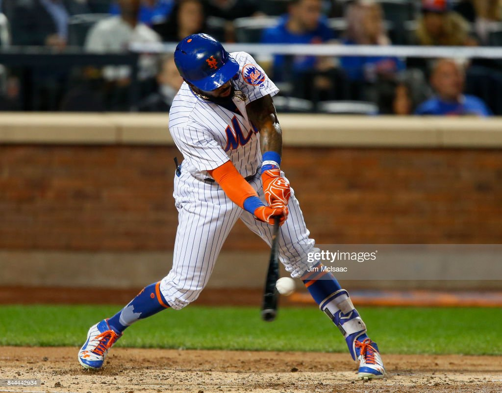 Jose Reyes #7 of the New York Mets connects on a fifth inning two run home run against the Cincinnati Reds at Citi Field on September 8, 2017 in the Flushing neighborhood of the Queens borough of New York City.