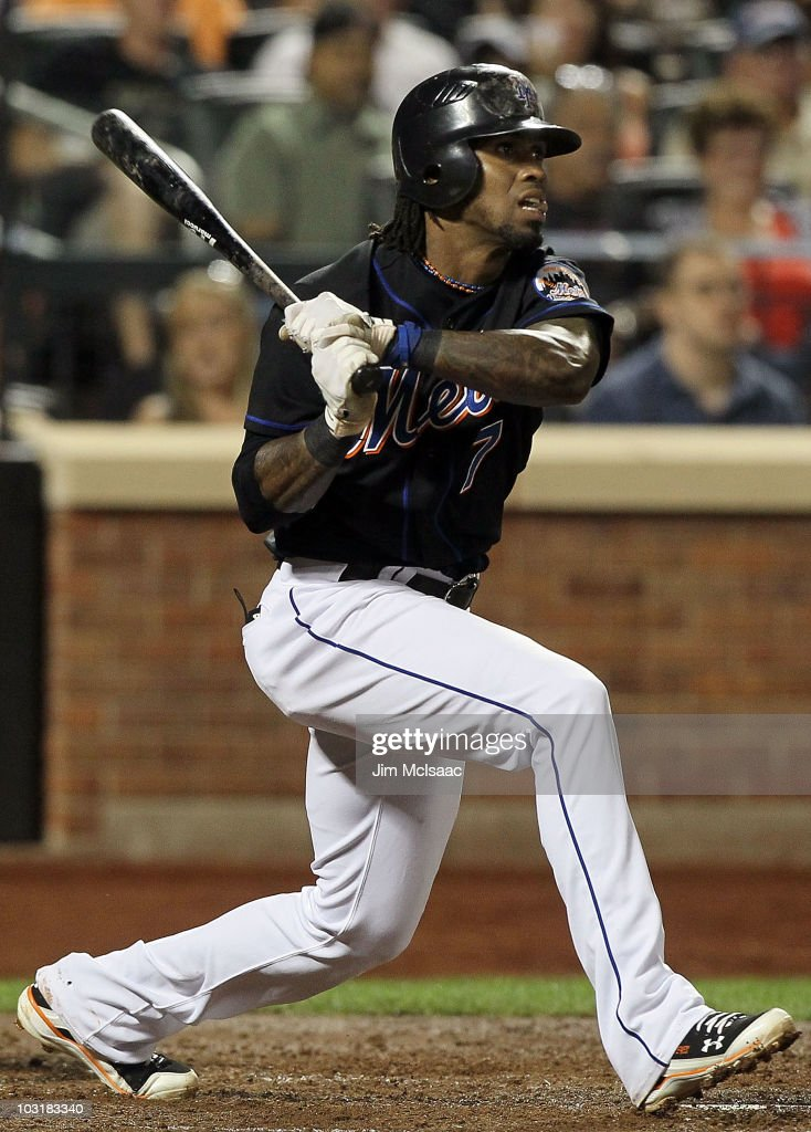 Jose Reyes #7 of the New York Mets follows through on a fifth inning RBI single against the Arizona Diamondbacks on July 31, 2010 at Citi Field in the Flushing neighborhood of the Queens borough of New York City.
