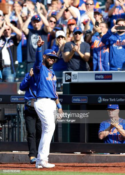 Jose Reyes of the New York Mets gestures to the crowd after being taken out of the game during the first inning against the Miami Marlins at Citi...