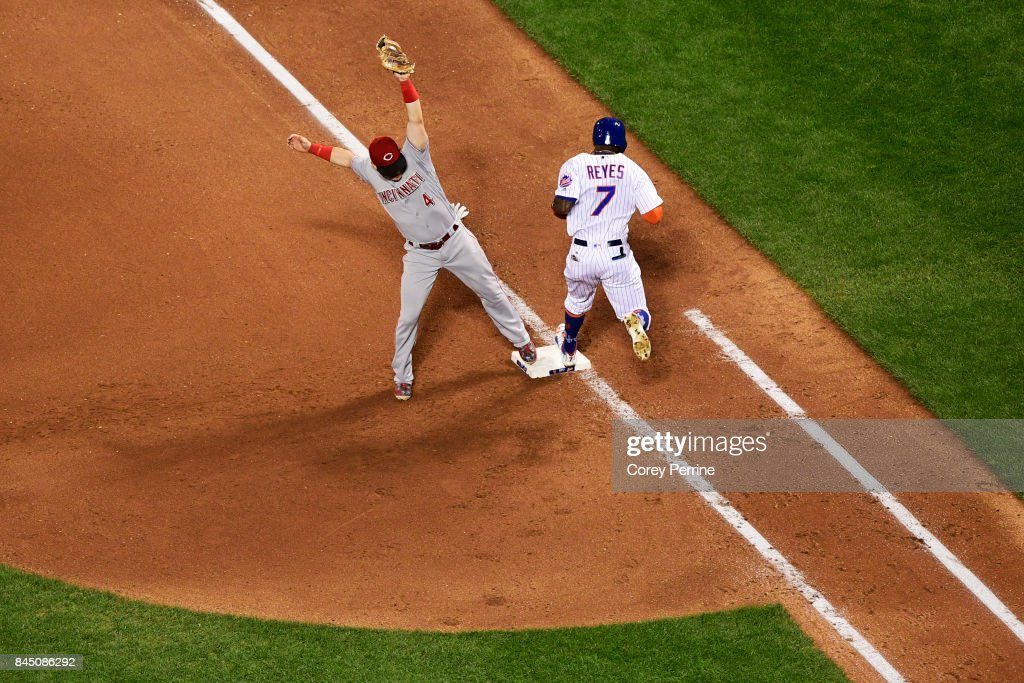 Jose Reyes #7 of the New York Mets is tagged out at first base as Scooter Gennett #4 of the Cincinnati Reds makes the tag during the seventh inning at Citi Field on September 9, 2017 in the Flushing neighborhood of the Queens borough of New York City. The Mets won 6-1.