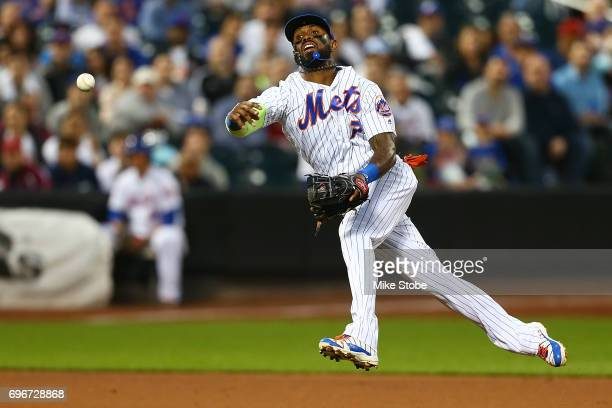 Jose Reyes of the New York Mets is unable to throw out Ryan Raburn of the Washington Nationals for an infield single in the fifth inning at Citi...