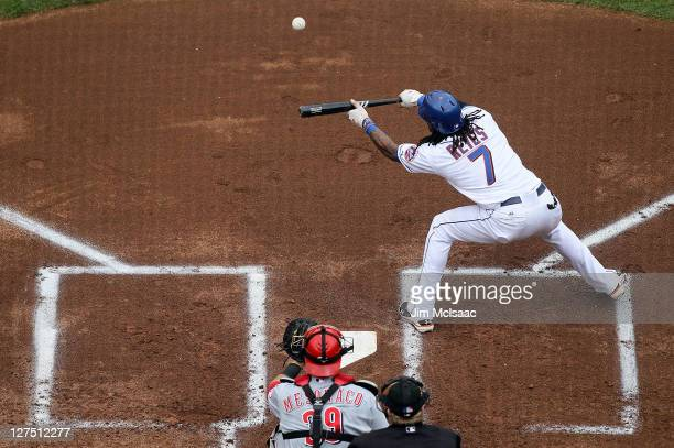 Jose Reyes of the New York Mets lays down a first inning bunt single in his only at bat against the Cincinnati Reds at Citi Field on September 28...