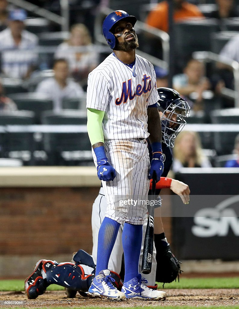 Jose Reyes #7 of the New York Mets reacts after he struck out in the ninth inning as Tyler Flowers #25 of the Atlanta Braves defends on September 20, 2016 at Citi Field in the Flushing neighborhood of the Queens borough of New York City.