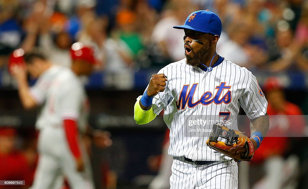 Jose Reyes #7 of the New York Mets reacts as he runs off the field after a seventh inning ending double play against the Philadelphia Phillies at Citi Field on September 23, 2016 in the Flushing neighborhood of the Queens borough of New York City.
