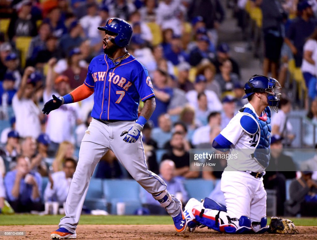 Jose Reyes #7 of the New York Mets reacts to his two run homerun behind Yasmani Grandal #9 of the Los Angeles Dodgers to trail 8-6 during the seventh inning at Dodger Stadium on June 19, 2017 in Los Angeles, California.