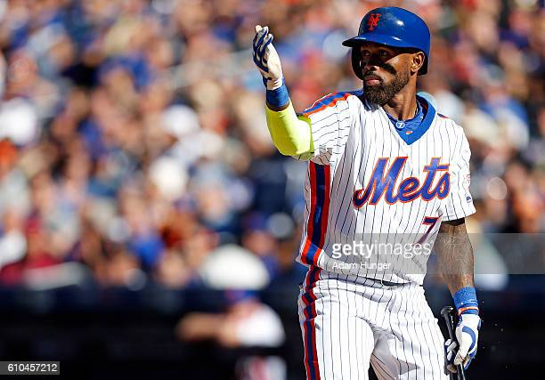 Jose Reyes of the New York Mets signals for Jay Bruce of the New York Mets to score on a wild pitch by Colton Murray of the Philadelphia Phillies...