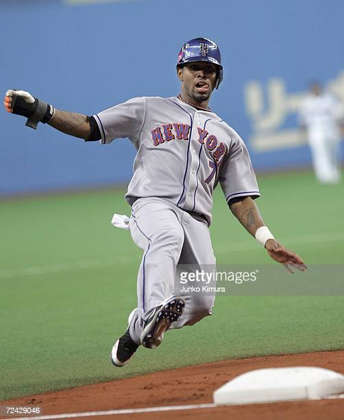 Jose Reyes of the New York Mets slides into the third base during the Aeon All Star Series Day 4 MLB v Japan AllStars at the Kyocera Dome on November...