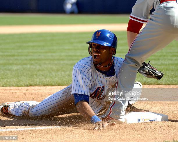Jose Reyes of the New York Mets slides into third base during a MLB game against the Philadelphia Phillies at Shea Stadium on September 15 2007 in...