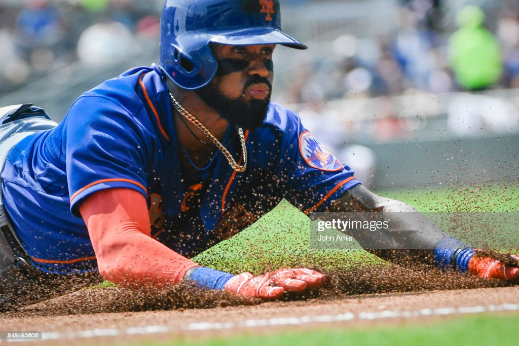 Jose Reyes #7 of the New York Mets slides to third base during a one run line drive triple to left field against the Atlanta Braves in the first inning at SunTrust Park on September 17, 2017 in Atlanta, Georgia.