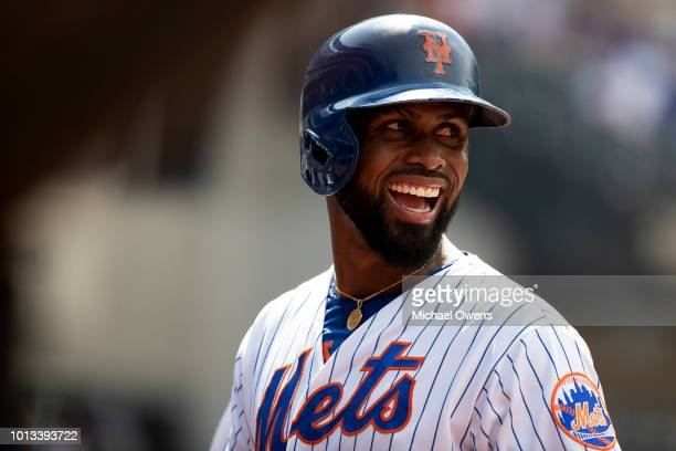 Jose Reyes of the New York Mets smiles in the seventh inning during the game against the Cincinnati Reds at Citi Field on August 8 2018 in the...