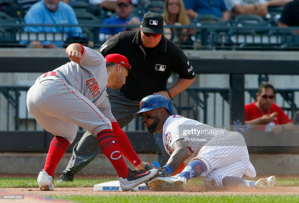 Jose Reyes #7 of the New York Mets steals third base in the sixth inning against Eugenio Suarez #7 of the Cincinnati Reds at Citi Field on September 10, 2017 in the Flushing neighborhood of the Queens borough of New York City.